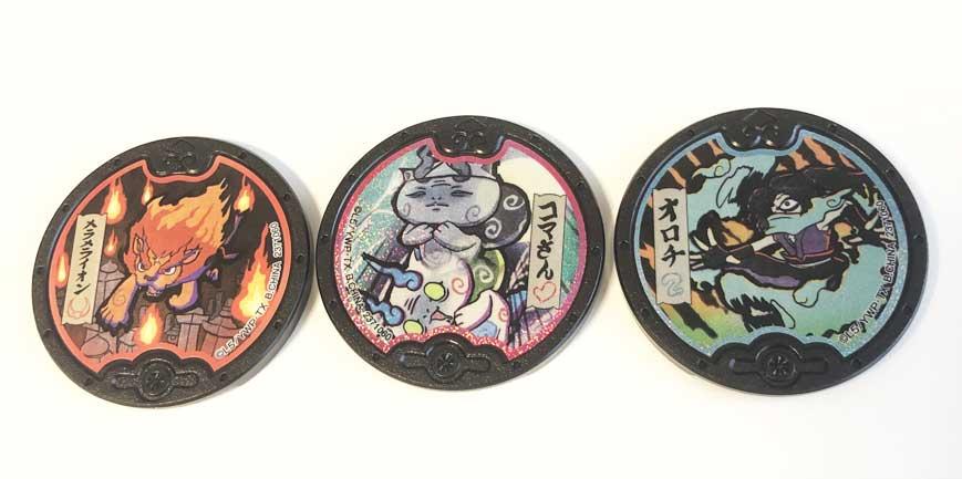 黒い妖怪メダルの画像